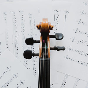 violin neck over music sheets